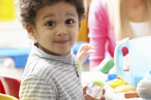 boy-playing-with-toys-in-nursery-xs