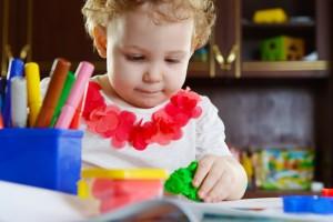 eoc-waytogrow-photodune-4490865-little-girl-playing-with-clay-dough-xs