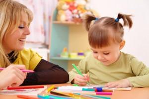 eoc-waytogrow-photodune-700554-teacher-with-child-in-preschool-xs
