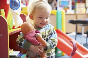 young-girl-playing-with-toys-xs
